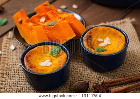 Cottage Cheese And Pumpkin Pudding With Cinnamon And Nutmeg On Wooden Background.