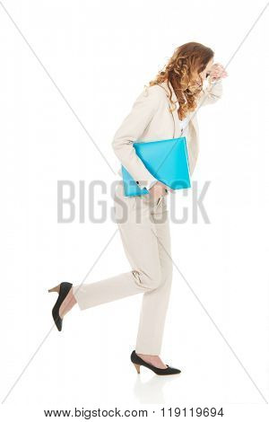Tired businesswoman with binder.