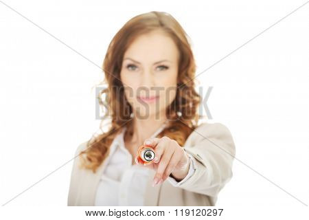 Businesswoman pointing on camera with pen.