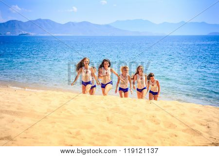 Cheerleaders In White Blue Steps Out Of Sea Smiles On Beach