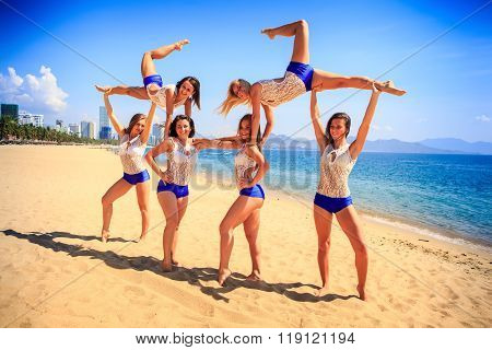 Cheerleaders Perform Sideview Swedish Falls On Beach Against Sea