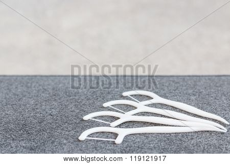 Oral Device : white dental floss on fabric background