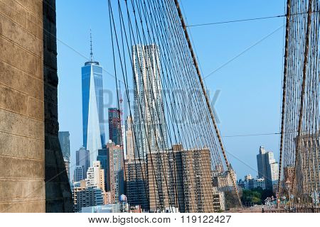 View of Manhattan City Skyline Featuring One World Trade Center Skyscraper on Sunny Day with Blue Sky, New York City, New York, USA as seen from Brooklyn Bridge Pedestrian Walkway