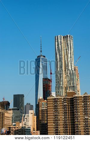 New York City Skyline with Gleaming One World Trade Center Building in Background on Sunny Day with Clear Blue Sky, New York City, New York, USA