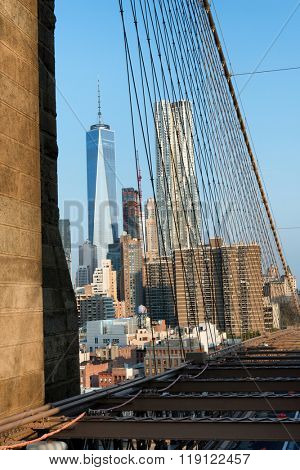 View of Manhattan City Skyline Featuring One World Trade Center Skyscraper on Sunny Day with Blue Sky, New York City, New York, USA as seen from Brooklyn Bridge