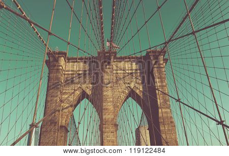 Low Angle View of Arches of Brooklyn Suspension Bridge in New York City, New York, USA, Looking Up at Blue Sky with Vintage Tone