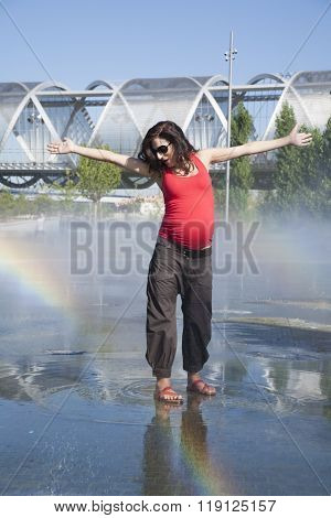 Pregnant Dancing On A Fountain