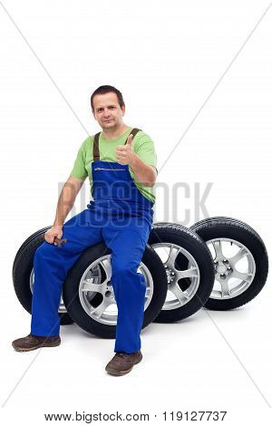 Car Mechanic With A Set Of New Tires