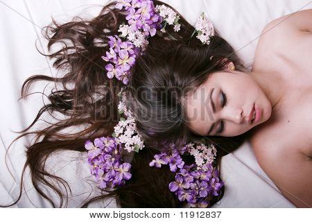 Beautiful asian woman lying on bed