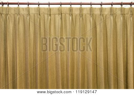 Brown curtains hang on