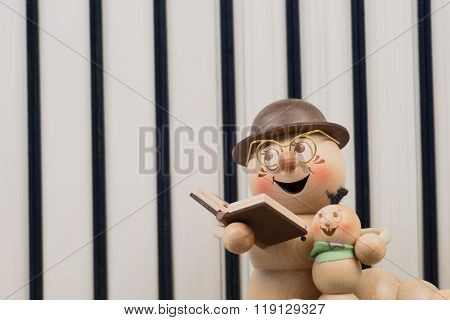 bookworm in front of a row of books