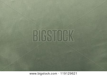 Grained Textured Background From Fabric Of Pale Green Monochrome Color