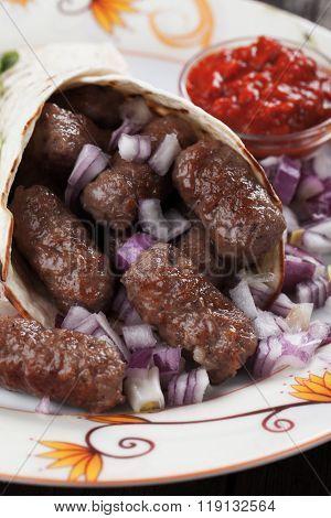 Cevapcici, bosnian minced meat kebab wrapped in pita bread