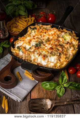 Baked Pasta With Broccoli, Cauliflower, Cheese And Bechamel Sauce