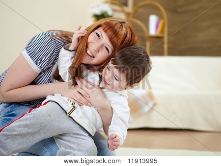 young mother playing with her little son