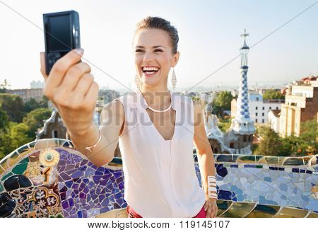 Woman Taking Selfie With Photo Camera In Park Guell, Spain