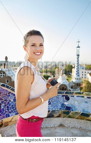 Woman Tourist Holding Photo Camera While In Park Guell, Spain