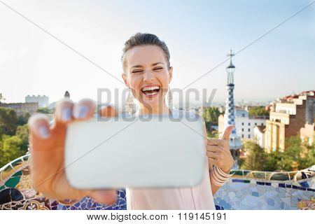 Woman Showing Thumbs Up And Taking Selfie With Mobile, Spain