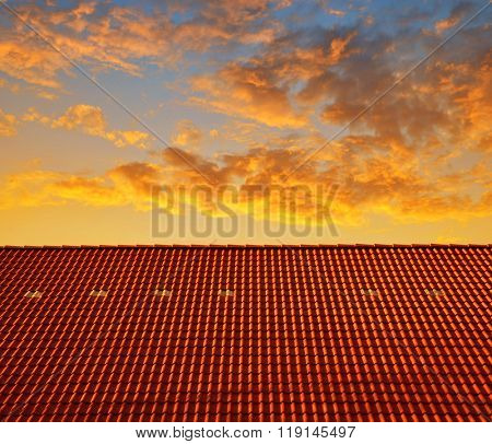 Roof house with tiled roof at sunset