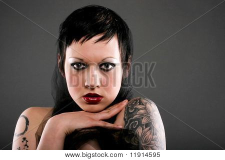 goth style makeup. Stock photo : Beautiful young woman with gothic style short hair and makeup