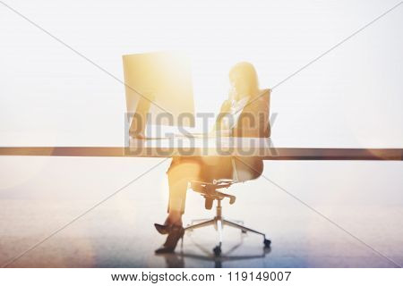 Photo of businesswoman working at a table in modern office. White background