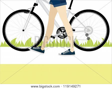 Young Girl With Slender Legs Leads Her Bike On Road