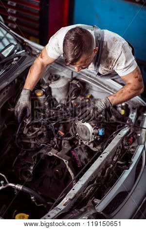 Service Station Worker Diagnosing Vehicle
