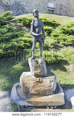 Figure of a pissing knight next to the castle in Nowy Sacz, Poland