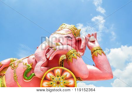 pink Ganesh statue on blue sky