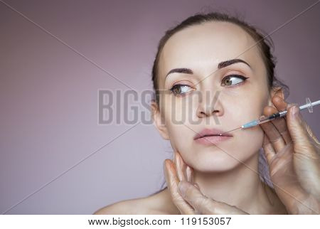 Young Pretty Woman Getting Cosmetic Injection In The Face