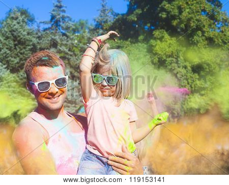 Happy Young Father With Daughter On Holi Color Festival