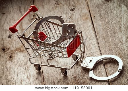 Shopping Cart And Handcuffs