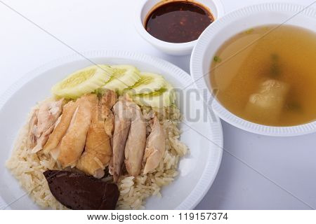 Hainanese chicken rice, steamed chicken, chicken blood and white rice on white background.