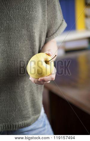 Yellow Apple On Hand Woman