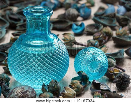 Blue Glass Bottle Surrounded By Dried Plants