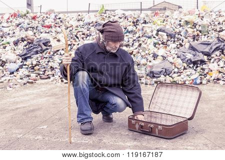 Homeless Collects Alms From The Suitcase