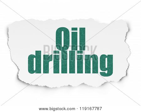 Industry concept: Oil Drilling on Torn Paper background
