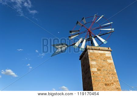 Typical majorcan windmill with blue sky in background