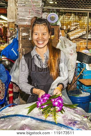 Women Sells Fresh Orchids At The Flower Market