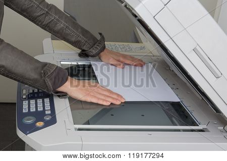 Woman's Hand With Working Copier At Work