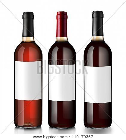 Bottles of red wine with empty labels, isolated on white