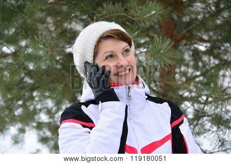 Sport Woman Talking On Phone In  Pine Winter Forest