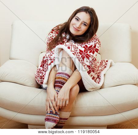 yong pretty brunette girl in Christmas ornament blanket getting warm on cold winter, freshness beaut