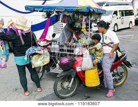THAILAND, PATTAYA, MARCH, 27, 2015 - Thai woman sells the prepared meal no a scooter in Pattaya, Thailand. From government stats there are over 10,000 registered street vendors in Pattaya