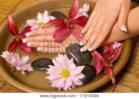 Woman rejuvenating her hands in water