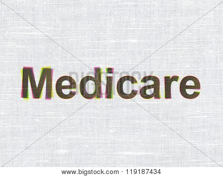 Healthcare concept: Medicare on fabric texture background