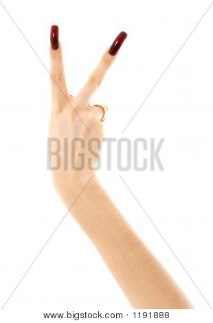Hand With Long Acrylic Nails Showing Victory Sign