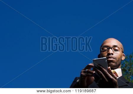 Businessman using handheld computer