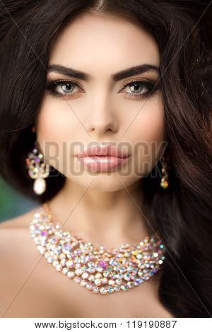 Beautiful model woman beauty salon makeup Young girl luxurious spa Lady make up Mascara long lashes lips lipstick eye shadow hair manicure nail polish Products Treatment Jewelry necklaces earrings