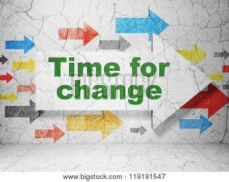 Time concept: arrow with Time for Change on grunge wall background